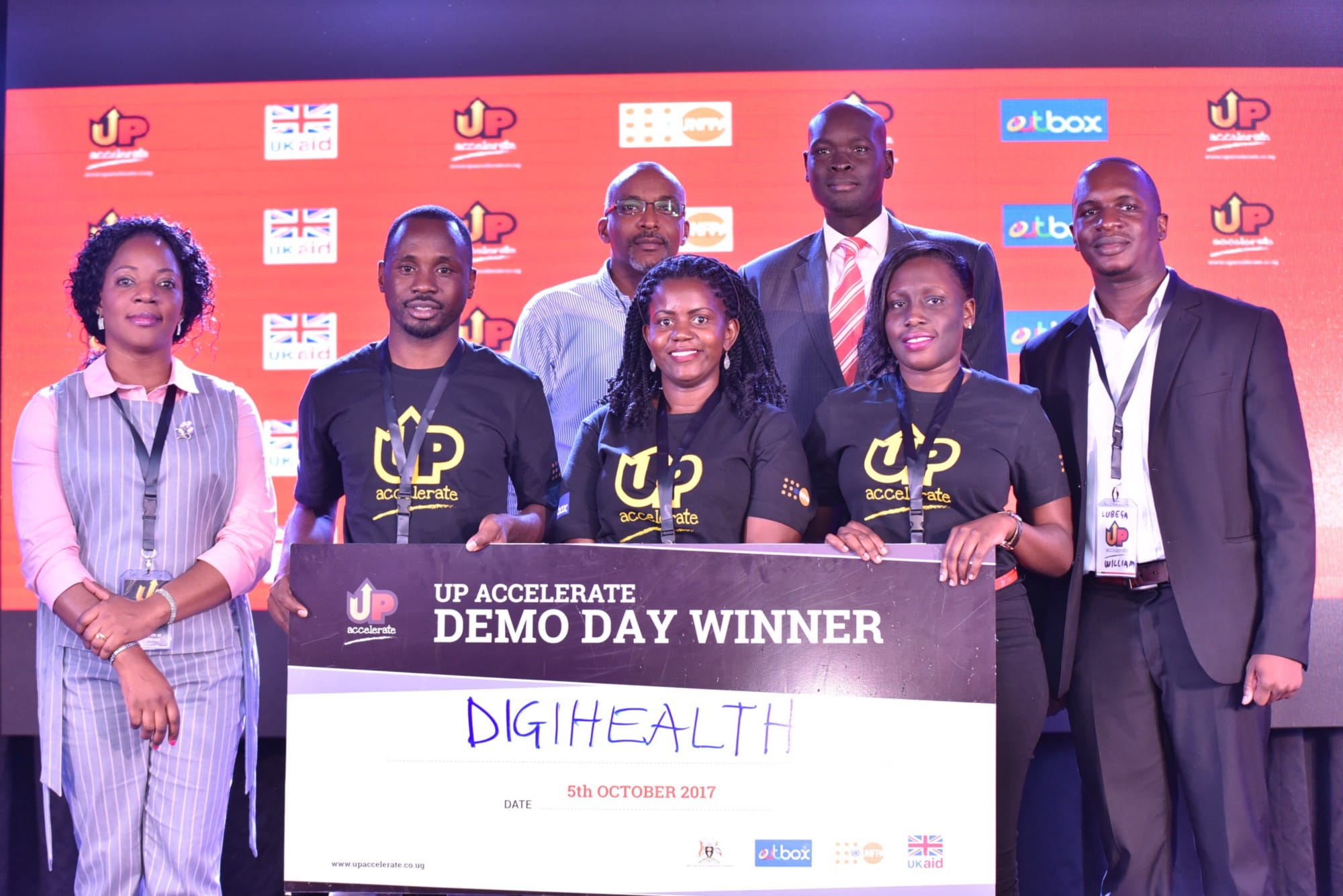Team Digihealth pose for a photo with the judges at the Up Accelerate Demo day after being announced winners.