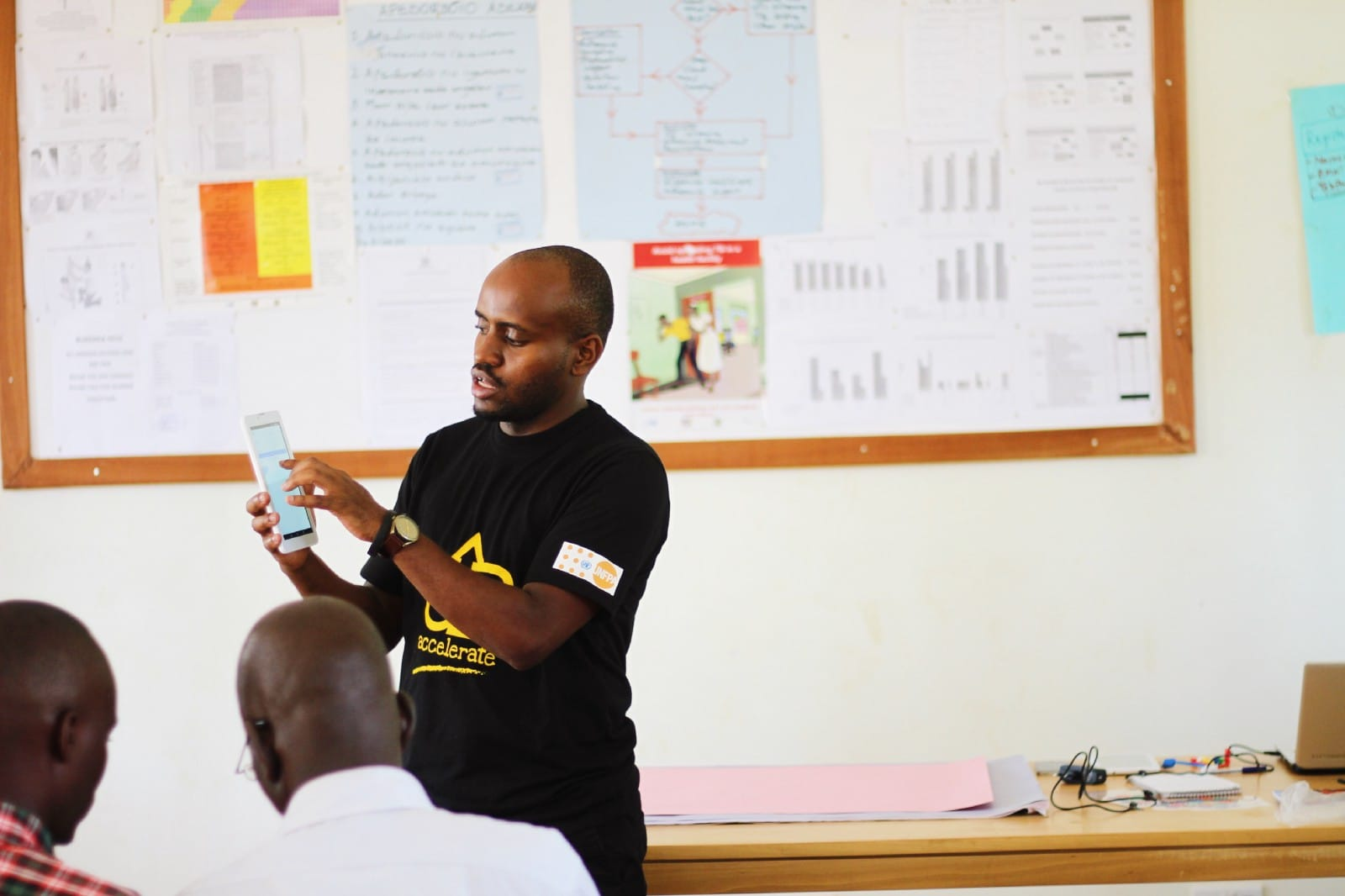 Solomon Kahuma conducting a training for health workers in Bukedea District on how to use DrugDash
