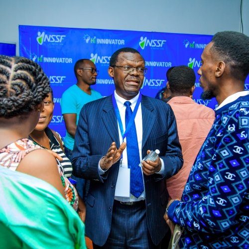 NSSF Deputy Managing Director, Patrick Ayota, speaking to some of the small business owners during an information session on the programme held at Outbox.